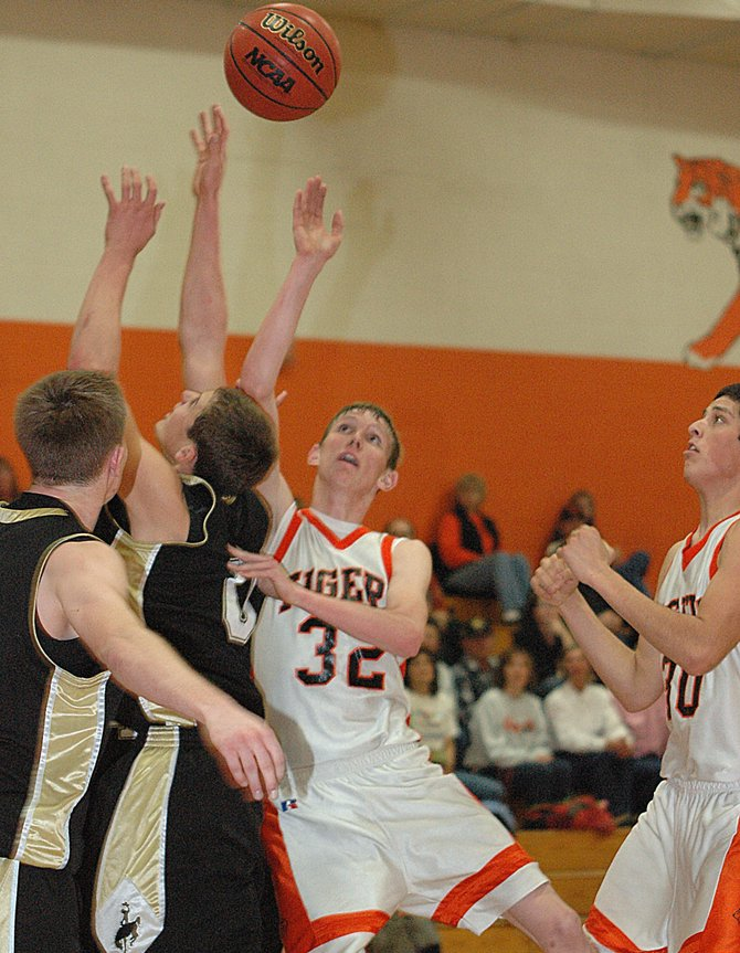 Hayden High School's Murphy Smartt tries to grab a rebound last week as the team lost at home to Meeker. Hayden went on to win Saturday against Vail Christian and will attempt to build on that momentum tonight as they travel to Soroco. The Tigers beat the Rams, 63-54, in December.