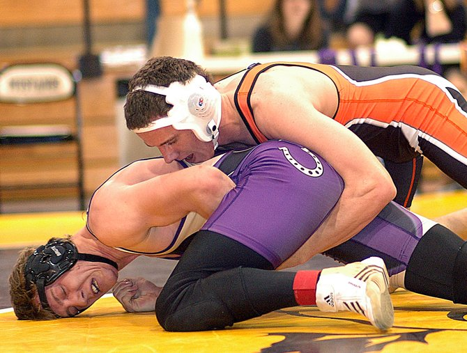 Mitch Doolin wrestles last month in the Western Slope League tournament. He was one of five Tigers to win their weight divisions that day. The team hopes for similar success this weekend as the Tigers compete for a chance to go to the state wrestling tournament in Denver.