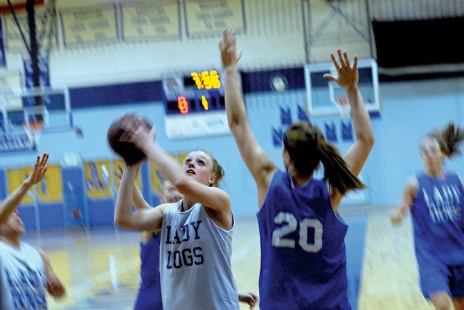 Moffat County High School senior Danielle Kawcak takes a shot Thursday during practice drills. The girls and boys basketball teams will be squaring off today against visiting Glenwood Springs.