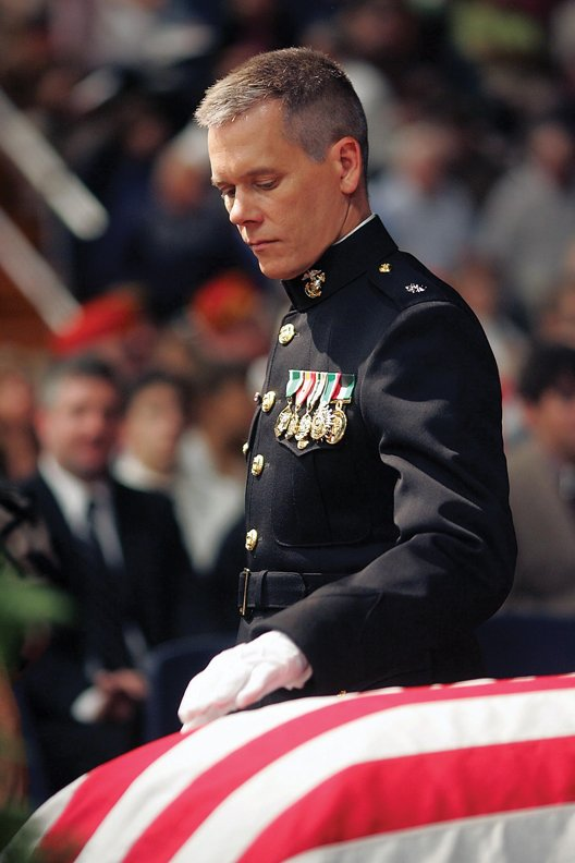 "Kevin Bacon portrays Lt. Col. Michael Strobl, of the U.S. Marine Corps, in the upcoming movie, ""Taking Chance."" The movie is"