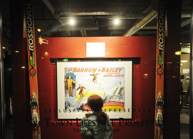Nine-year-old Madeline Boucher, of Steamboat Springs, looks at a display facing Lincoln Avenue through a window of Howelsen Place on Feb. 6 during the opening of a discovery center being used to help market several downtown developments by Green Courte Partners.