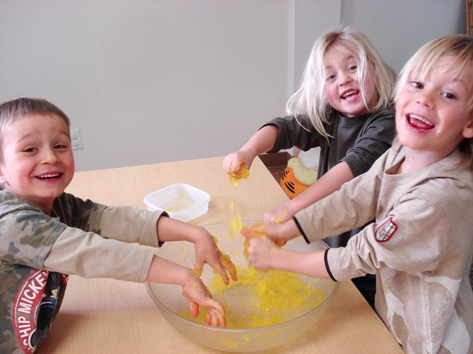 Pee Wee Adventures participants, from left, Niklas Malacinski, Giovanni  DeMusis and Ian Heydon learn about the letter G by making and playing with a gel recently at the Pee Wee Adventures program.
