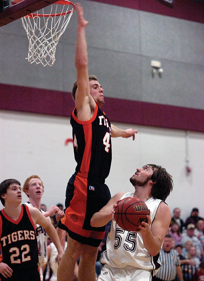 Hayden High School senior Zach Barnes towers over Soroco's Matt Watwood on Friday as the Tigers beat the Rams, 47-42. The win cast the rivals, along with Rangely, into a three-way tie for third place in District 5.