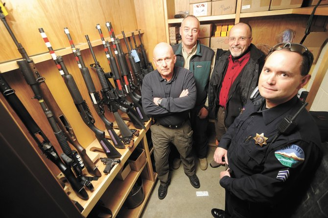 A shooting range for a new Northwest Colorado Law Enforcement Training Facility might be partly operational as soon as early summer for local law enforcement. Sheriff's Office investigators, from left, Ken Klinger and Mike Curzon, Steamboat Springs' director of public safety J.D. Hays and Sgt. Miles DeYoung, of the Sheriff's Office, are involved with the project.