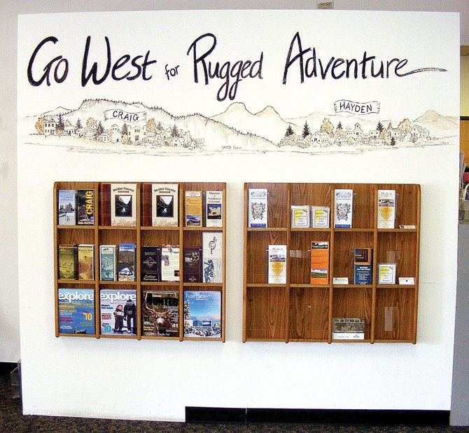 Officials want the new Yampa Valley Regional Airport display for Moffat County and Hayden to showcase what both communities can offer tourists coming into the area. The Moffat County Tourism Association and Hayden Chamber of Commerce contributed funding to the space, including the purchase of new brochure racks and contracting a local artist to design and paint the mural.