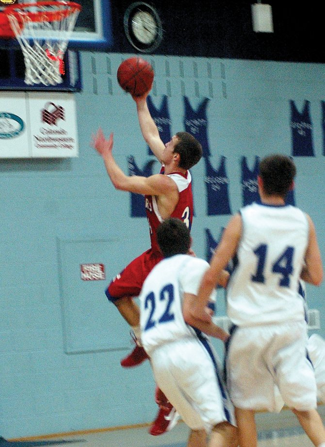 Steamboat senior Charles Wood goes in for a layup Tuesday at Moffat County High School. The Sailors lost, 41-38, on a last-second 3-pointer by the Bulldogs&#39; Thomas Noble. 