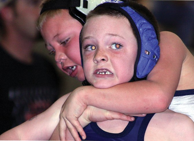 Bad Dogs wrestlers Daniel Caddy, front, and Jake Shelton square off Saturday at the Mat Cat Invitational in Fruita. Shelton and Caddy competed against one another for first place in the 6 and under, 55-pound weight class, a match that coach Rodney Klimper said was one of the hardest-fought matches of the day.