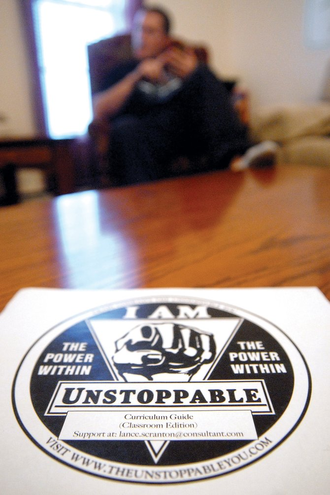 """Lance Scranton talks Wednesday about the curriculum he created from Craig Conrad's book, """"Unstoppable."""" Scranton, a Moffat County High School teacher, worked with Conrad to develop the curriculum, which is based off stories from the book."""