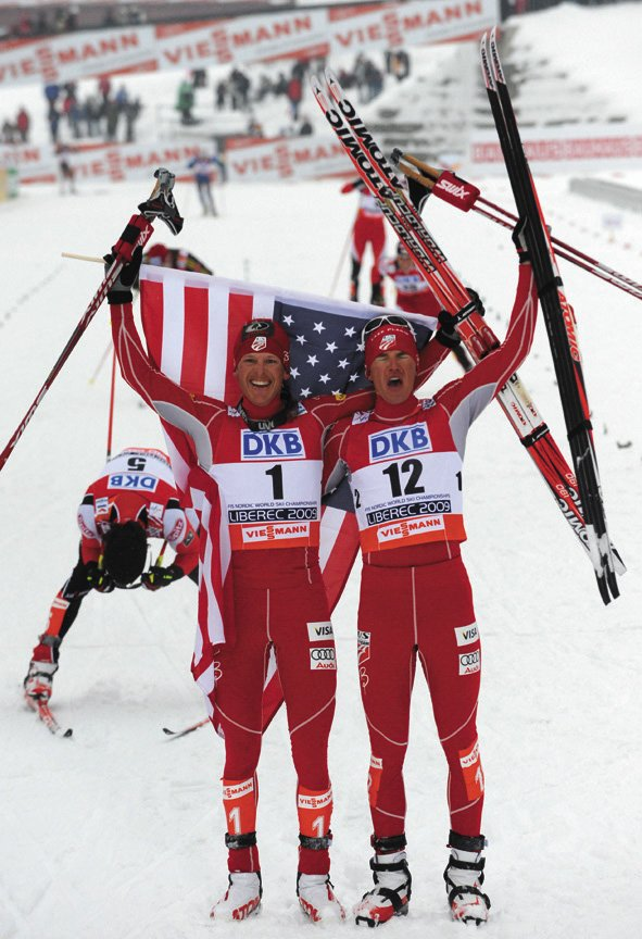 Todd Lodwick, left, celebrates his victory with teammate Bill Demong after the 10K individual Gundersen event of the Nordic skiing world championships Sunday in Liberec, Czech Republic. Lodwick won the race ahead of Jan Schmid, of Norway. Demong took the bronze.