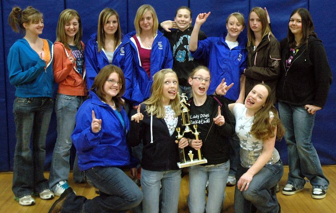 The Craig Middle School girls basketball team celebrates with the championship trophy the team won Feb. 14 in Meeker. The Bulldogs finished the season 12-0. Front row, from left: Dakota Lee, Sassy Murray, Tori Snyder and Jessie Scott. Back row, from left; Lisa Camilletti, Makayla Camilletti, Kori Finneman, Bailey Hollander, Kylee Ellgen, Molly Nations, Britni Harrington and Andi Daugherty.