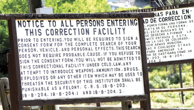 Signs at the entrance to Rifle Correctional Center will remain standing now that the facility is off the state's budgetary chopping block. State Sen. Al White, R-Hayden, was the driving force behind an effort to keep the prison and its 47 full-time employees safe from the flurry of budget cuts sweeping the Capitol.