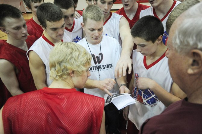 Steamboat Springs High School basketball coach Luke DeWolfe, center, shows his players pictures of their Skyline opponents, whom they will play at 7 p.m. tonight at home in the first round of the postseason tournament.