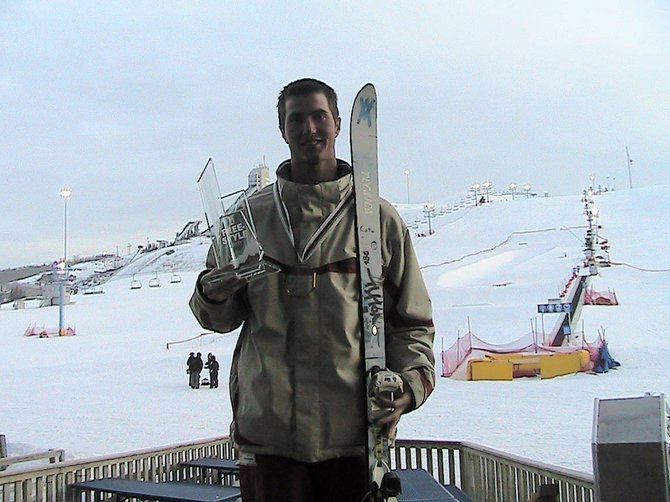 Jeremy Cota poses with his trophy after winning the freestyle mogul NorAm Grand Prix. Cota's win qualified him for the World Cup finals in France later in March.