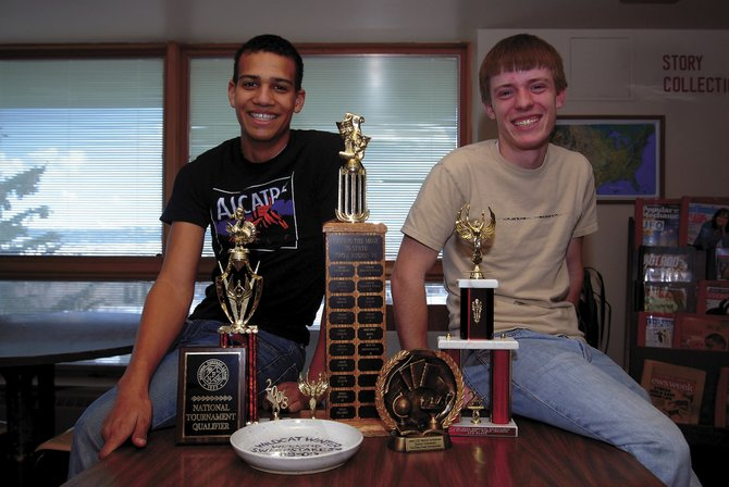 "Junior Curtis Lorio, left, and senior Michael Zehner pose with trophies the Moffat County High School Speech and Debate Team has earned this season. Coach Eric Hansen calls it the ""most successful season"" in a decade. Recently, Zehner qualified for nationals in the Senate competition, while Lorio placed high in the drama competition at the ""biggest speech tournament in the nation."" Both are among 16 students who qualified for the upcoming state tournament."