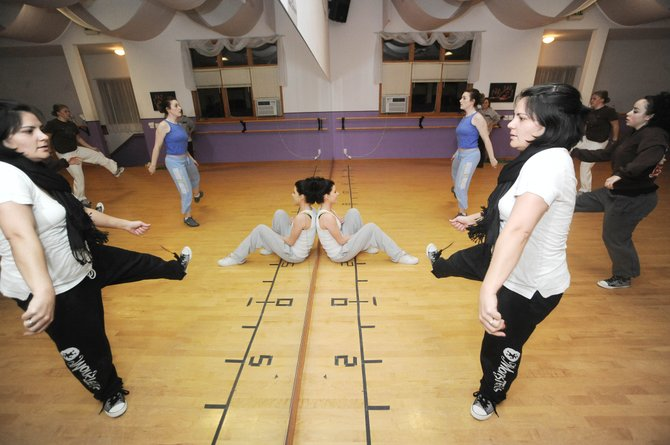 Choreographer Tiana Buschmann, front, practices with her dance group Thursday night during rehearsal at Northwest Ballet Studio. The group will perform the &quot;It Was All In Your Mind&quot; piece March 5 to 7 during the annual Dance Showcase at Steamboat Springs High School.