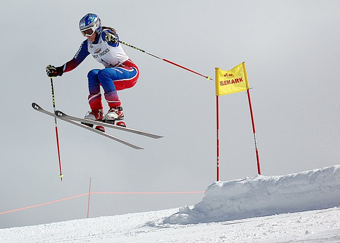 Kelsey Schmid-Sommers flies over the mid-run jump on the Telemark giant slalom course at the Steamboat Ski Area. Schmid-Sommers, a Whitefish, Mont., racer in town for the U.S. Telemark National Championships, finished second in the women's division behind Steamboat skier Lorin Paley.