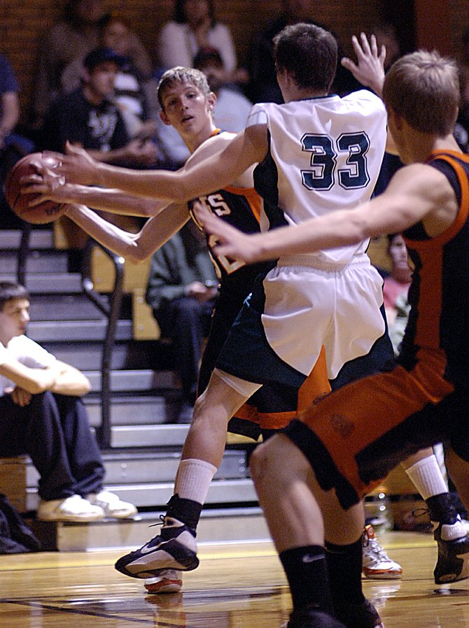 Hayden High School junior Murphy Smartt looks to pass to Zach Engle in Friday&#39;s 55-52 loss to Plateau Valley in the district tournament. The Tigers lost the game after grabbing a 10-point second-quarter lead.