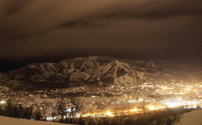 The yellow lights of the city reflect off the low hanging clouds that blanketed Steamboat Springs on Thursday night.