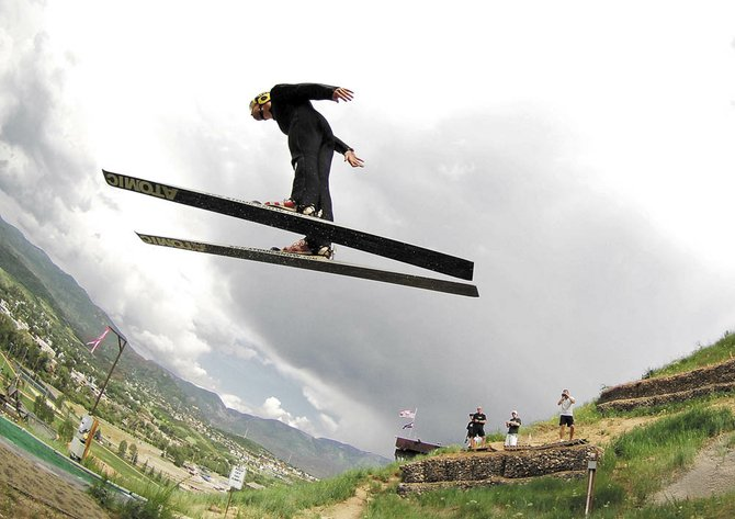 This photo featuring Utah ski jumper Kyle Lockhart at Howelsen Hill, taken by John F. Russell, won first place for a sports photo at the Colorado Associated Press Editors and Reporters annual awards ceremony Friday night in Denver.