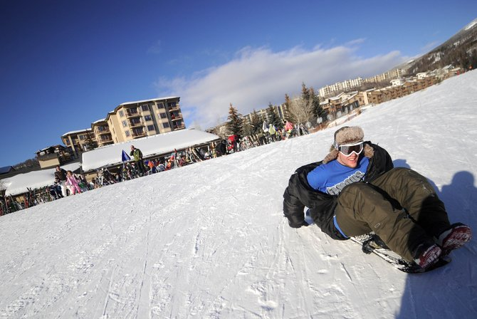 Atlanta resident Greg Cannon rides his snowboard down Headwall on Friday at Steamboat Ski Area after spending some time at Slopeside Grill for aprÃs ski. The base area is being looked at for $15 million in infrastructure improvements, which would include a creek feature.