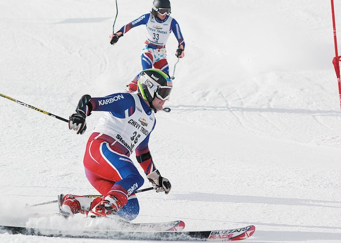 Eric Lamb, foreground, and David Hobbs race down Howelsen Hill on Sunday during the dual slalom race, a part of the U.S. Telemark National Championships, which wrapped up its four-day stay in Steamboat Springs with the light-hearted dual slalom.