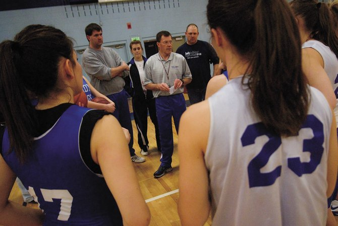 Moffat County High School girls basketball coach Craig Mortensen addresses his team Wednesday at the beginning of practice. The Bulldogs face the top-ranked Broomfield Eagles today in the Sweet 16 round of the 4A high school girls basketball state playoffs.