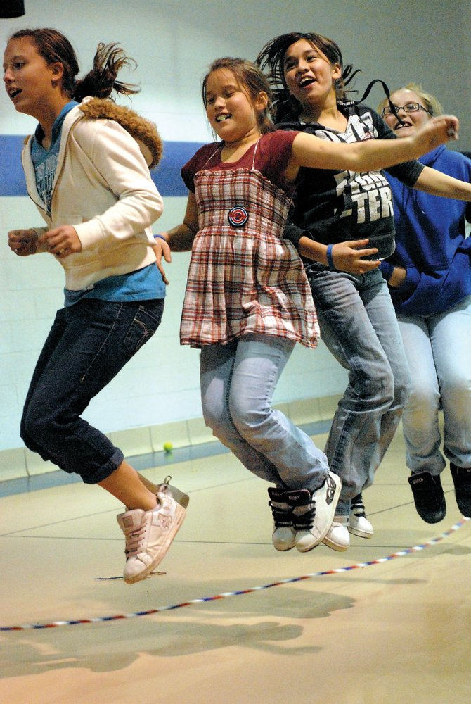 From left, Tiawna Smercina, Jasmin Garcia, Catalina Garcia and Stevie Masterson, all 12, jump rope Thursday during an energy burner period at the Boys & Girls Club of Craig. School district officials say there is a lack gym space and are proposing the expansion of an auxiliary gym at Craig Middle School. The proposed gym would be used for students and the community.