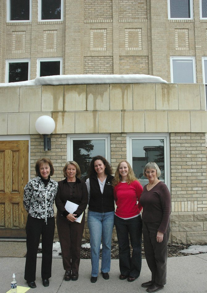Routt County Human Services Director Vickie Clark, left, stands with her child support services team outside the Routt County Courthouse. The team, from left, includes Nancy Smith, Carolyn Gibson, Mariah Poole and Sherry Camilletti.