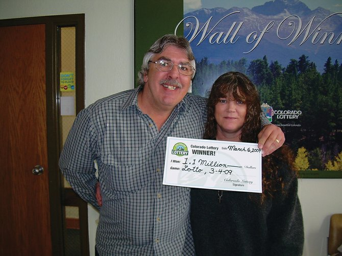Craig residents Leo and Pam Fournier hold their check for an advertised $1.17 million in Colorado Lotto winnings. On Thursday, the couple drove to Grand Junction soon after learning they won. They said they didn't sleep until after they collected their prize from the Colorado Lottery office at about 9 a.m. Friday.