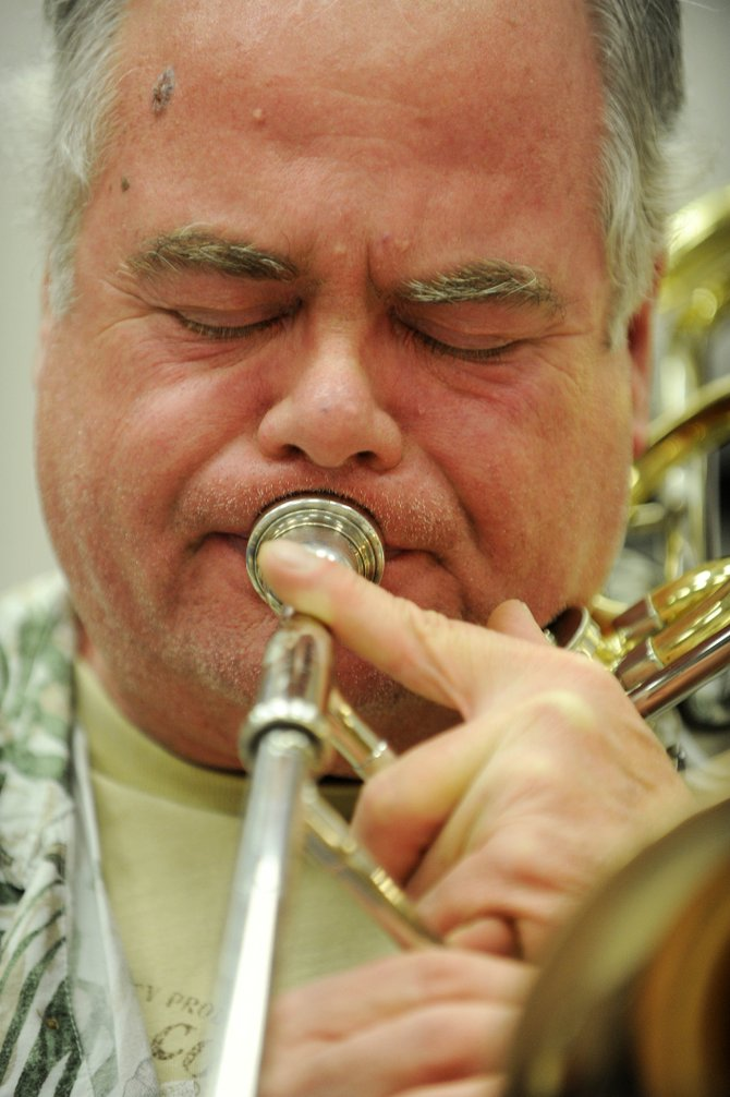 Steve Smith plays a trombone solo Thursday night during a Steamboat Swings rehearsal at Steamboat Springs High School. The group has its first gig March 21 at a community dance in the Steamboat Grand Resort Hotel ballroom.