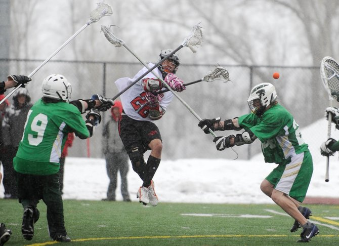 Steamboat Springs High School lacrosse player Chase Grippa takes a shot during Saturday's match against Summit County High School. Steamboat won, 8-5.
