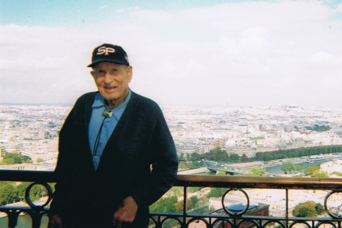 John Fetcher stands at the top of the Eiffel Tower in fall 2006.