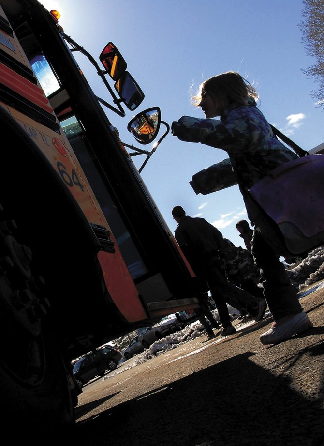 Kaitlyn Ahlstrom boards a Moffat County School District bus Tuesday at East Elementary. If the Moffat County School Board passes a plan to redistrict the schools, 330 students would have to change schools next year. Moffat County School District administrators met with parents Tuesday night to answer questions about the plan.