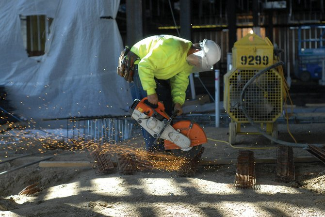 Rafielo Alonso cuts rebar Wednesday at the new The Memorial Hospital site. Robins & Morton officials have said that construction on the project is on time and on budget for its projected November completion date.