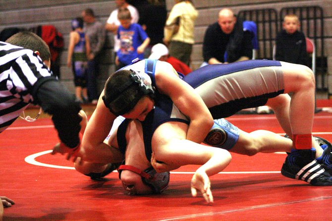 Bad Dogs wrestler Deven Mosman, bottom, attempts to keep his back off the mat Saturday during the Lil Warrior Classic in Grand Junction. Teammate T.J. Shelton, top, won the match on his way to a first-place finish in the event.