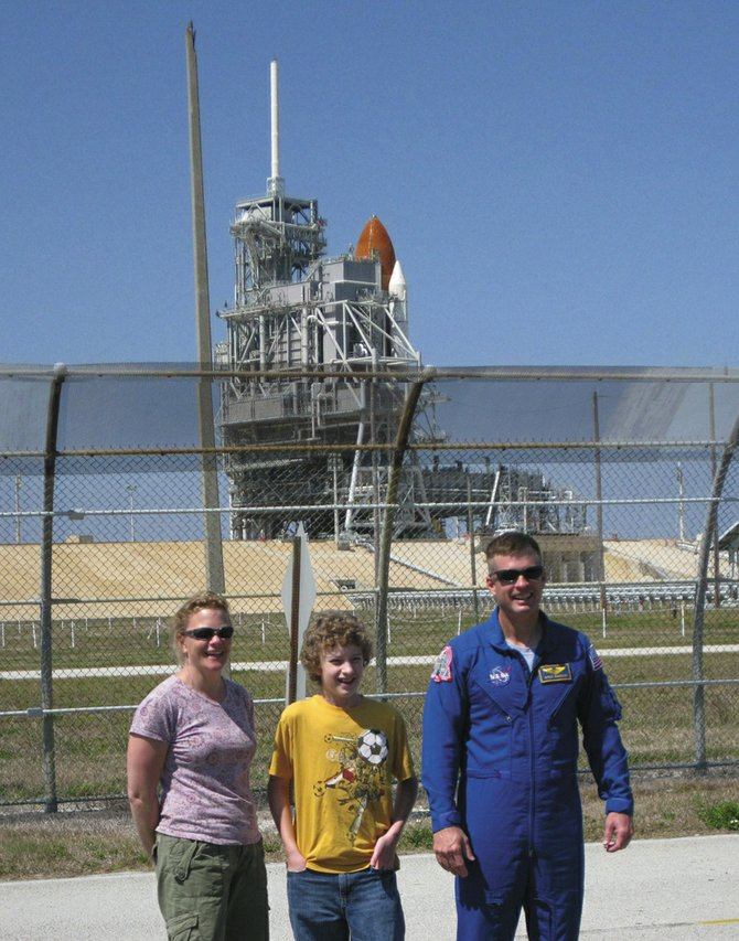 NASA astronaut and 1979 Steamboat Springs High School graduate Steve Swanson says goodbye to his wife, Mary, and son Quinn on Tuesday at the Kennedy Space Center in Florida. Wednesday's scheduled launch of the Space Shuttle Discovery was delayed until Thursday.