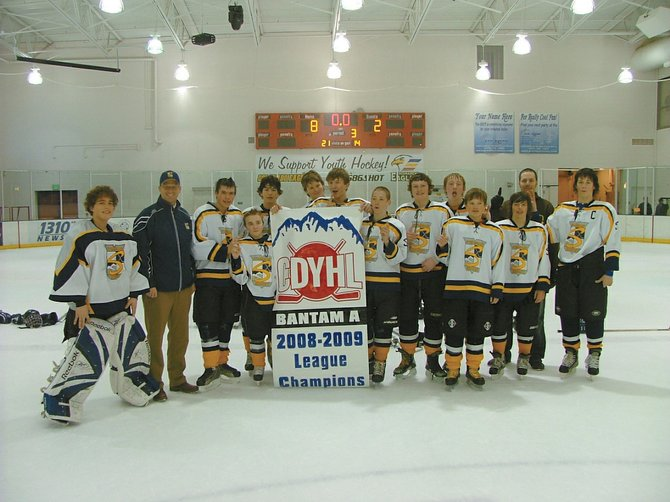 The Steamboat Bantam A team celebrates after winning its league championship during the weekend. The team, along with three other Steamboat Youth Hockey teams, is preparing for the state championships at The Edge in Denver on Friday and Saturday.