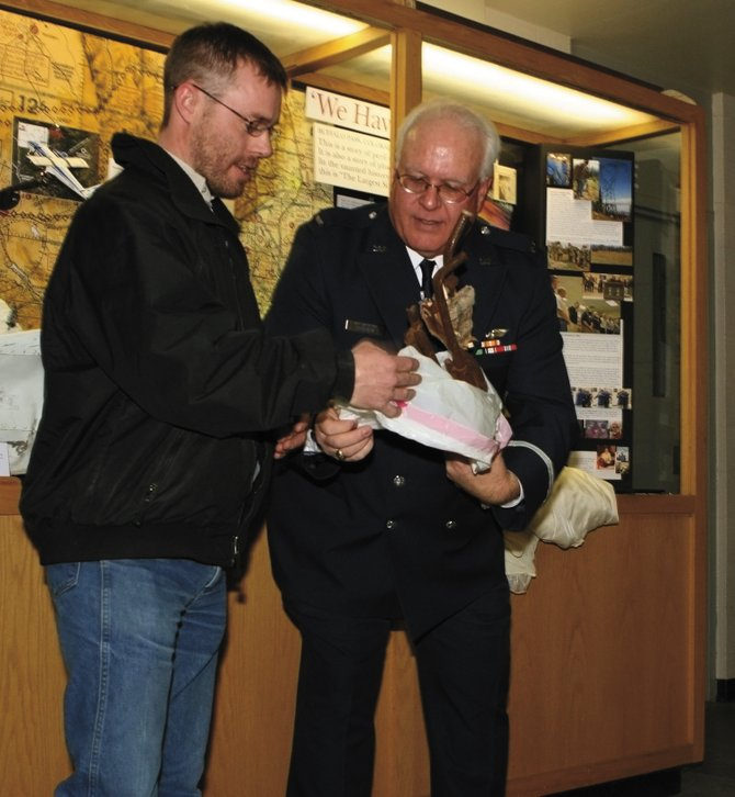 Steamboat Springs resident Matt Kotts, right, visits the Wings Over the Rockies Air and Space Museum in Denver on March 5 with Civil Air Patrol historian Ed O'Brien. As an infant, Kotts survived the crash of Rocky Mountain Airways Flight 217, a commercial flight that fell from the sky over Buffalo Pass during a snowstorm in December 1978. Two of the 22 on board lost their lives. The museum has opened an exhibit about the crash.
