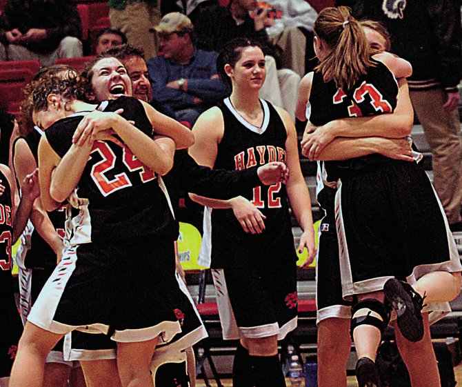 The Hayden girls basketball team celebrates after the final seconds ran off the clock in their 41-30 victory against Sanford in the opening round of the Class 2A state basketball tournament in Pueblo.