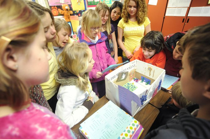 """Steamboat Springs Middle School sixth-grader Daria Standish reads in Spanish a description of the things that could be found in her ideal school Wednesday in Julie Warnke's Spanish class. Daria completed """"The Ideal School"""" project with classmates Kursten Keeler and Hannah Thvedt."""