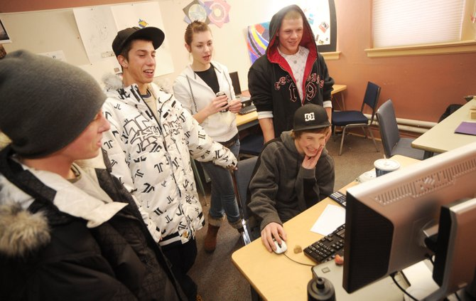 Yampa Valley School student Conner Bomberg shows classmates, from left, Mason Woolley, Scotty Baraw, Lejla Pecenkovic and Cole Breland a video for a class project Friday.