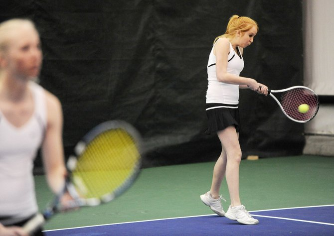 Steamboat Springs High School sophomore Sara Hoing returns the ball Saturday during her doubles match against Aspen. Hoing and her partner, Julia Cooper, left, lost the match, 6-2, 6-4.