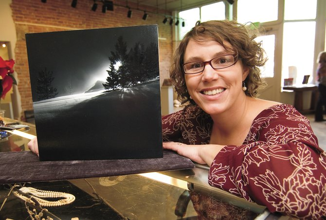 Photographer Paula Jo Jaconetta is one of 28 co-owners at Artists' Gallery of Steamboat. Sales for many of the gallery's artists have been down, she said. Steamboat Springs art gallery owners have noticed fewer sales overall and more popularity for smaller, less expensive work this winter.