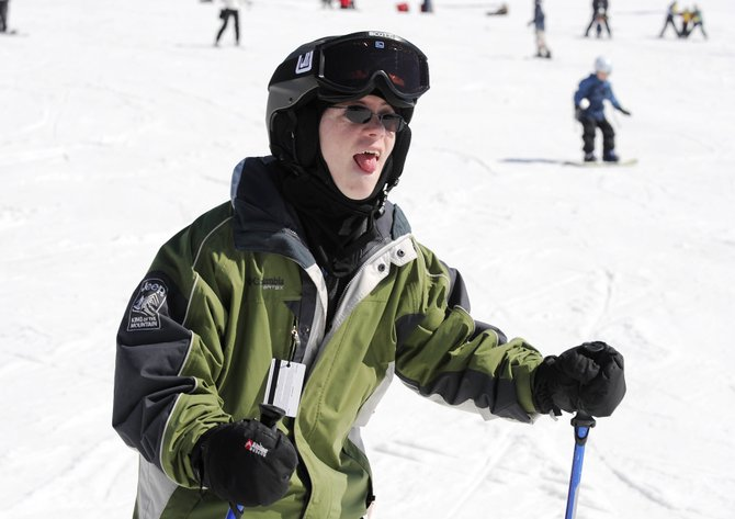 Steamboat Springs Special Olympian Scott Bjorgum takes a run Saturday at Steamboat Ski Area. Bjorgum is one of about 40 special needs athletes, who, along with 50 volunteers, have spent the past eight Saturdays at the ski area.