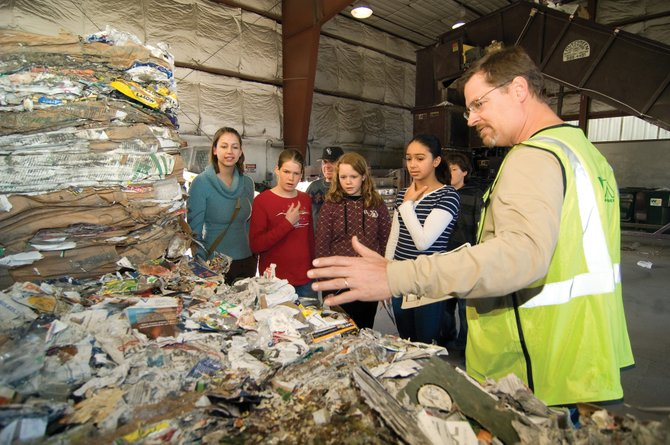 Steve Johnson, of Waste Management in Steamboat Springs, talks about recycling Monday evening to a group of middle school students from Hayden. The group was part of the Partners program and included, from left, mentor Jessica Schnittka and students Nicole Rauch, (Waste Management Territory Manager Zuff Zuffelato in back) Faith Carson and Laura Johnson.