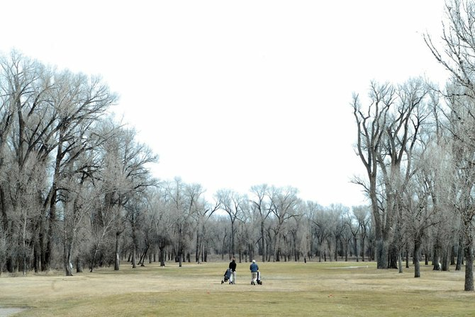 Wes Nelson, left, and Ted Leonhardt make their way down the second fairway Wednesday at Yampa Valley Golf Course. The course opened for business Tuesday, signaling the beginning of another season on the links in Craig.