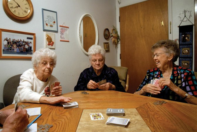 Margaret Thompson, from left, Vernice Self and Alma Crouch play a game of '65' at their joint birthday party Thursday. The ladies have been playing cards together for more than 20 years and share birthdays within a week of one another. Thompson turned 85, Self turned 90, and Crouch turned 95.