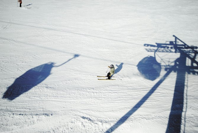 A skier weaves his way through the shadows of the gondola on the Heavenly Daze trail at Steamboat Ski Area. Steamboat&#39;s lodging is expected to be 63 percent full this weekend. It was 86 percent full last weekend.