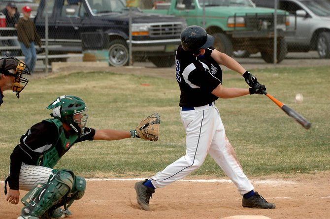 Moffat County High School outfielder Erick Leonard connects with a pitch last season against Delta. The Bulldogs opened the 2009 season Friday in Montrose with a doubleheader against Alamosa and the host Indians.