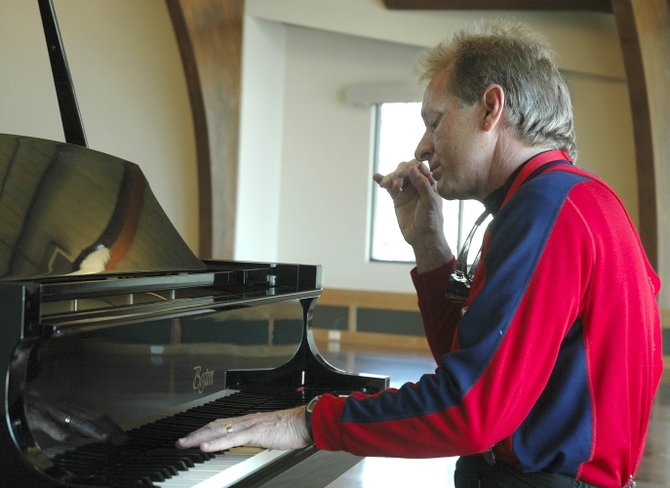 Pianist Rick Saint Pierre rehearses Thursday in the newly renovated Bud Werner Memorial Library's community room. Saint Pierre will perform today at a dedication ceremony for the library's renovation and expansion.